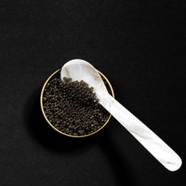Pearl spoon to taste caviar