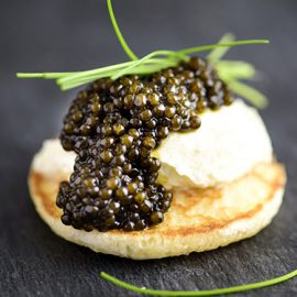Tasting of caviar on blinis